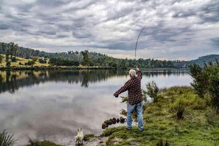 Senior fishing with his dog